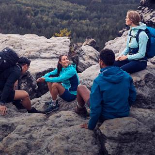 Hiking group sitting on rocks